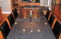 Arabian Black (Granite) Countertop and Backsplash with Undermount Sink and Cooktop Cutout. Edge- Double Ease