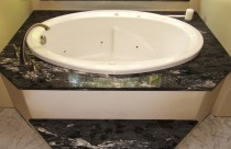 Forest Black (Granite) Bathtub Surround and Step. Edge- Double Ease