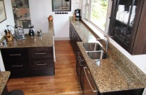 Giallo Vicenza (Granite) Countertops and Backsplash with Undermount Sink. Edge- Double Ease