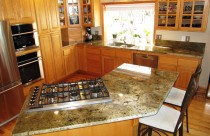 Mombasa (Granite) Countertops and Backsplash with Undermount Sink and Cooktop Cutout. Edge- Bullnose