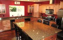 Tropical Brown (Granite) Counterops and Backsplash with Undermount Sink and Double Ease Edge