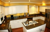 After -Tropical Brown (Granite) Countertops with Undermount Sink and Cooktop Cutout. Edge- Ogee