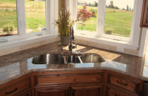 Crema Bordeaux (Granite) with undermount sink and half bull-nose edge.