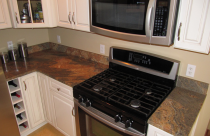 Indian Parana Honed (Granite) Countertop and Book Matched Backsplash with Double Ease Edge