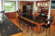 Absolute black Honed (Granite) Countertops with undermount sink and cooktop cutout and Reverse 45° Edge