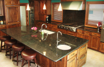 Suede (Granite) Countertop and full height backsplash with undermount sink and half bull-nose edge